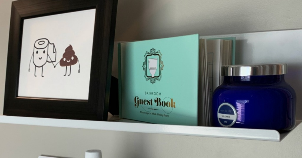 bathroom guest book on Collin's shelf.