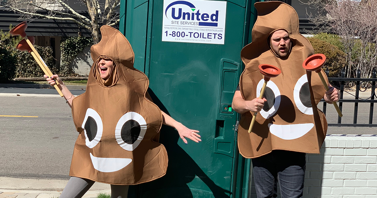 collin and stetson outside of port-a-potty in poop costumes