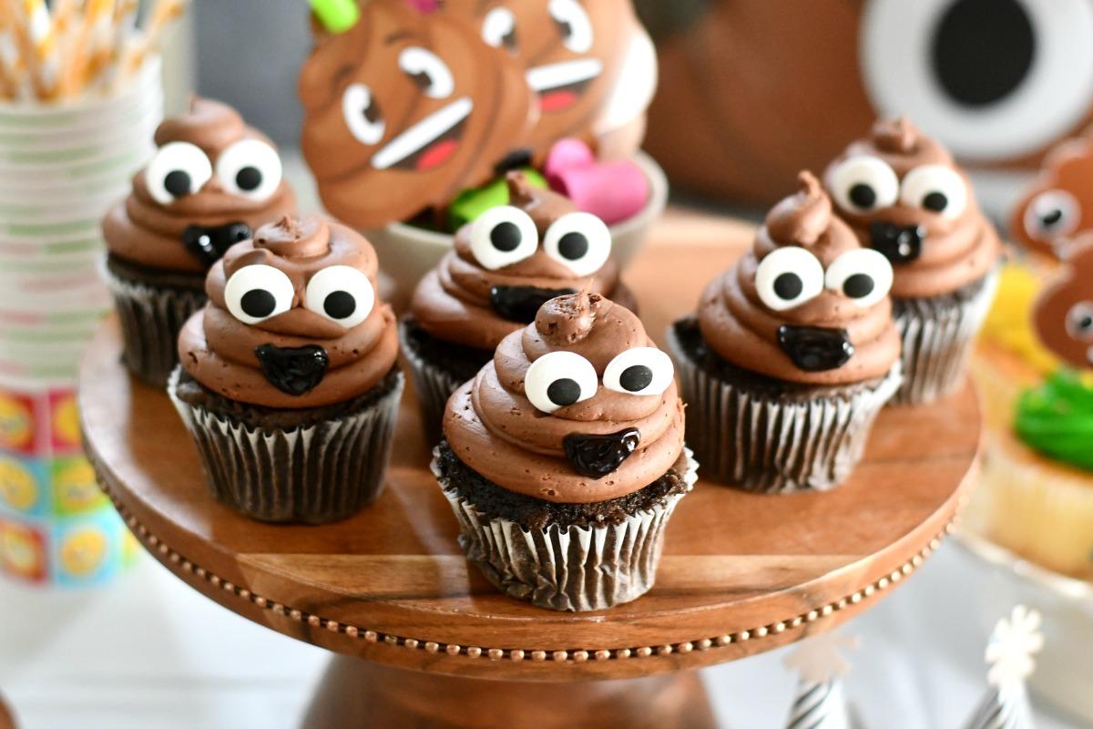 6 DIY poop emoji cupcakes on a cake plate