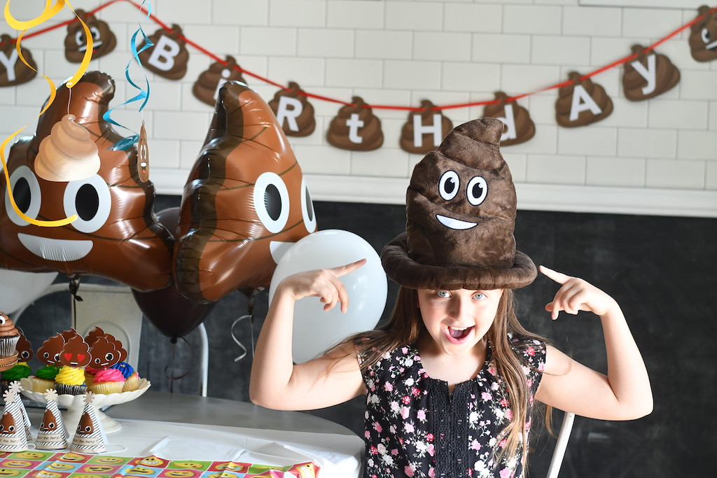 Wearing poop hat at poop party