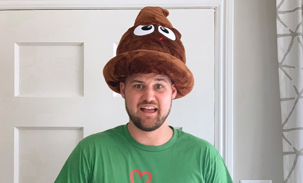 stetson wearing plush poop emoji hat